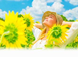 Woman in field of sunflowers