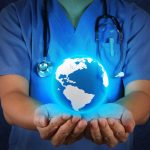 medical professional with globe in hand to demonstrate holistic healthcare