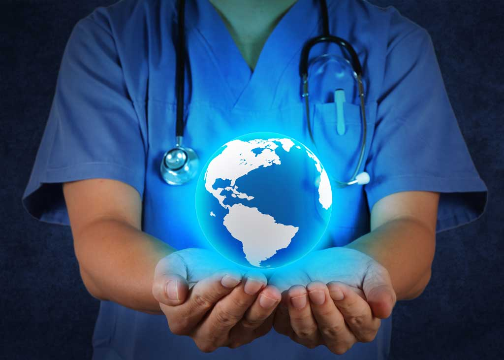 Globe in a healthcare providers hand to symbolize holistic health care