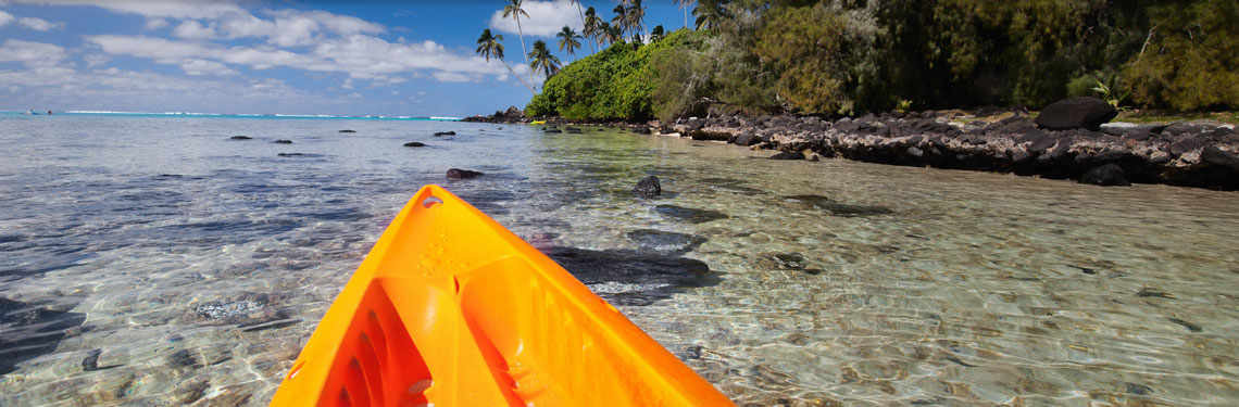 front of kayak in clear water